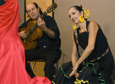 The guitarist and percussionist are pinned on the Flamenco dancer who is improvising.